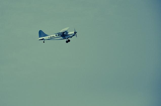 A small airplane flying on Ferrara - Italy