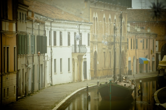 The small village of Comacchio in a foggy day, Italy