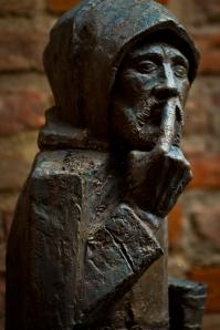 Monk, bronze statue in Bologna - Italy