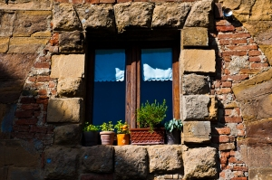 A colorful window in the sun - somewhere in Italy