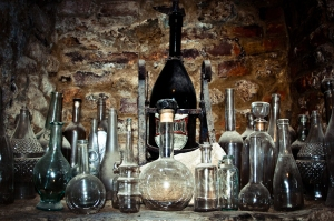 Collection of empty bottles in a wine-cellar, Italy