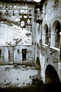 Mantova, renovation project - above the wall a shot dated 1908. Italy